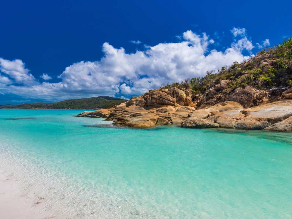 Rocks on Whitehaven Beach with white sand in the Whitsunday Islands easter holiday ideas